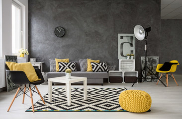 Grey living room with yellow details Wall mural