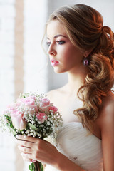 Beautiful woman with a wedding bouquet