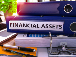 Blue Office Folder with Inscription Financial Assets on Office Desktop with Office Supplies and Modern Laptop. Financial Assets Business Concept on Blurred Background. 3D Render.