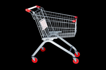 Shopping cart in marketing shop isolated on black background