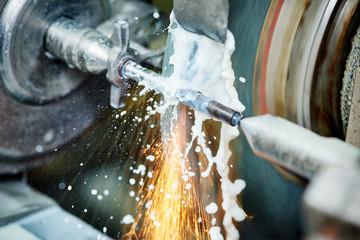 metalworking industry. finishing metal surface on grinder machine