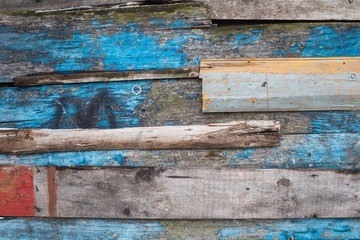 Vintage wood background. Grunge wooden weathered oak or pine textured planks. Grey, brown, blue rustic fence.