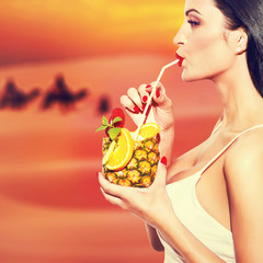 Thirsty woman drink pineapple juice atesert