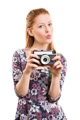 Beautiful young girl taking a picture