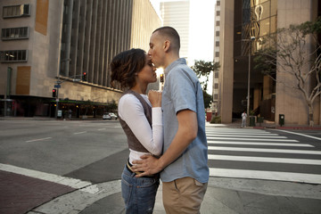 Couple kissing on city street