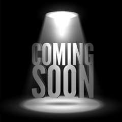Coming soon. Text in Spotlight shine effects on a dark background