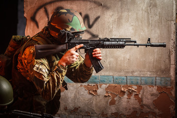 Soldier with the russian machine gun in abandoned building