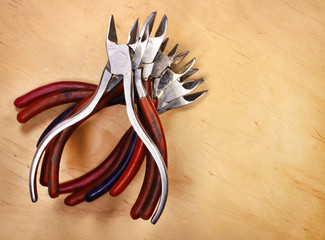 Stack of old used and dirty metal pliers and cutters