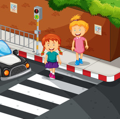 Two girls crossing the road