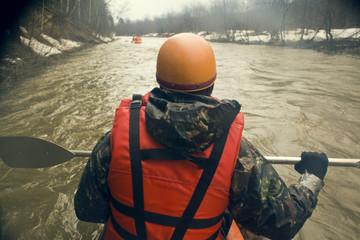 Mari man kayaking on snowy river