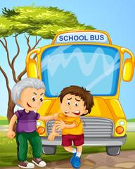 Bully boy picking on other boy in school bus