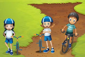 Three kids riding bike with helmet on