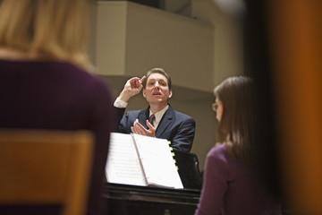 Conductor directing choir