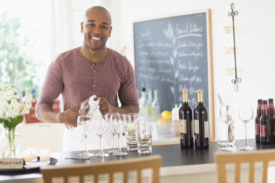 Black bartender smiling in restaurant