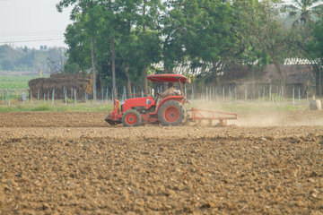 tractors plow the farm