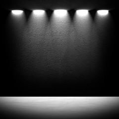 black concrete wall with spotlights