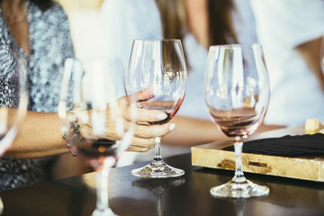 Women drinking wine together in bar