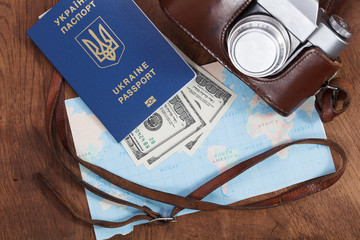 map, old camera and money . Travel concept