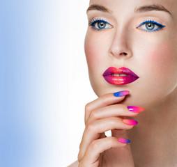 Beauty Woman Portrait. Professional Makeup and Manicure. Rainbow