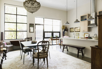 Windows, lighting and rug in dining room and kitchen area