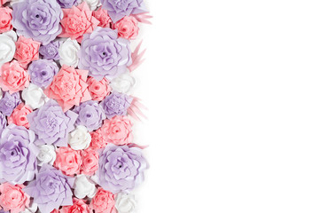 Colorful paper flowers background. Floral backdrop with handmade roses for wedding day or birthday.