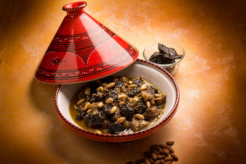 tajine with meat plum almond and sesame seeds
