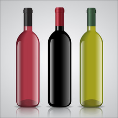 Three bottles of white and red wine with labels