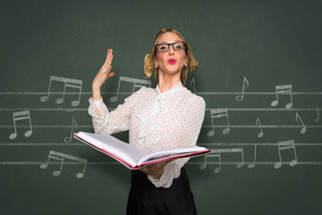 Vocal choir coach instructor nerdy singer singing in school classroom music teacher