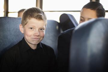 Boy smiling on school bus