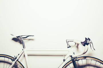 White vintage bicycle on white background