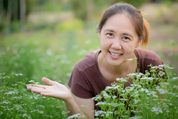 Asian young farmer in vegetable farm