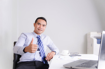 Happy smile asian business man showing thumb up with cheerful in