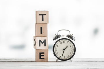Time concept with a clock and a word