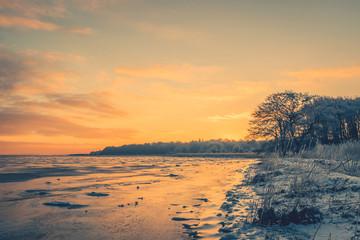 Frozen lake in the morning sunrise