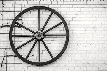 Old wheel hanging on a wall