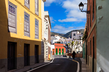 Summer cityscape on tropical island Tenerife, Canary in Spain. Street of old town Guia de Isora.