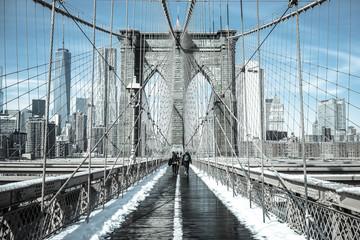 Winter in New York / Pedestrians cross snow-covered Brooklyn Bridge in February 2015