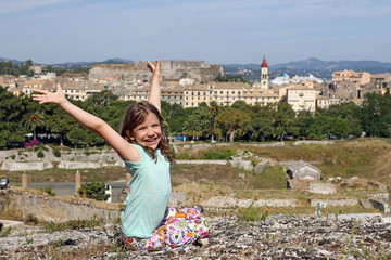 happy little girl on old fortress Corfu town Greece