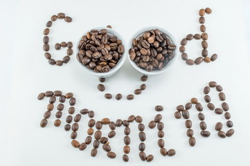 Two cups of coffee beans forming note