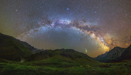 Milky Way arc over mountains