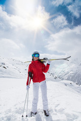 Young woman with ski on mountains