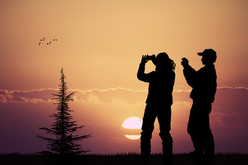 people photographing the sunset with their cell phone