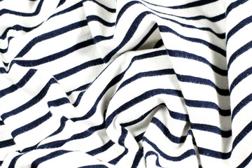 wrinkled black and white striped fabric