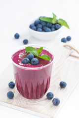 blueberry milkshake with mint and chocolate, vertical