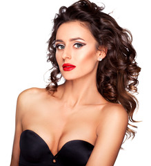 Young women with professional makeup and hairstyle in black luxu