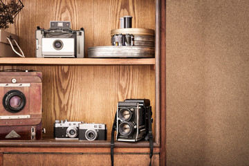 Photographer's cupboard. Photographer workplace. Vintage cameras. Vintage atelier. Hipster.