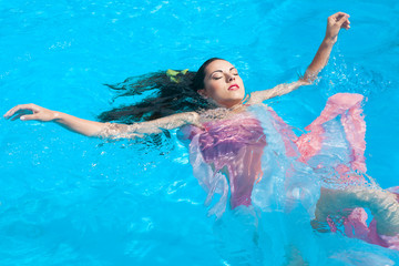 Portrait of a young beautiful woman in water