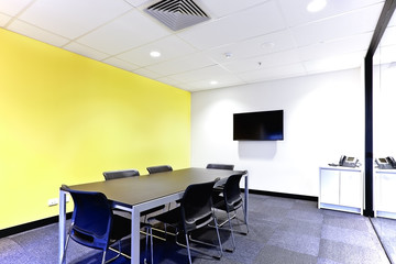 Conference room with black table and chairs covered walls