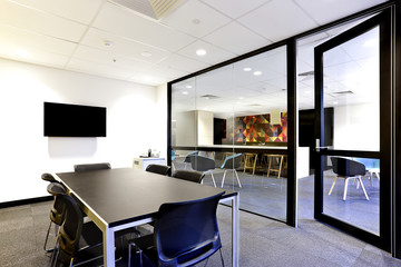 Conference room with black table with open glass door