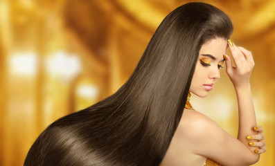 Beautiful Hair. Beauty brunette woman with luxurious long hair o